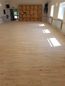 Finished floor with 1 coat of primer and 3 coats of 2 part commercial lacquer